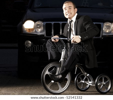 Young business man on tribike