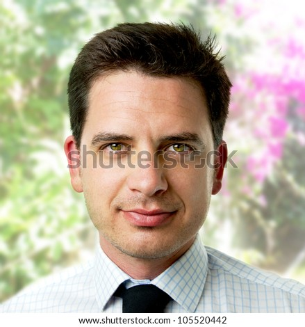 Young business man over wild forest background