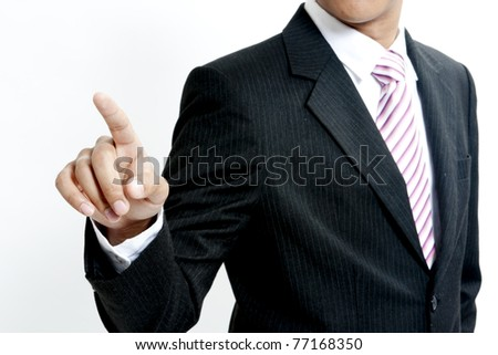 Young business man pointing to you