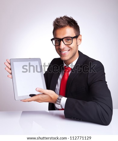 young business man presenting his new and cool tablet pad