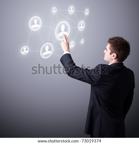 Young business man pressing a digital social network icon.