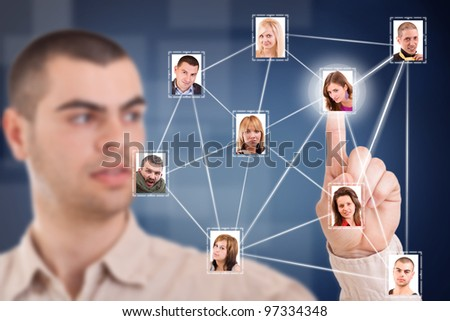 Young business man pressing Social network structure