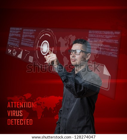 Young business man pushing digital button on interface