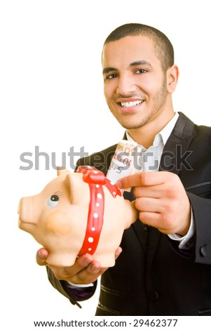 Young business man putting Euro banknotes in a piggy bank