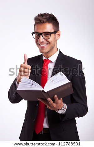 young business man reading about success in a good book