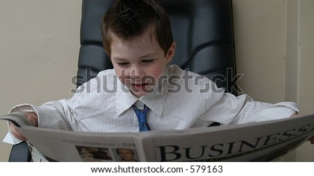 young business man reading the newspaper