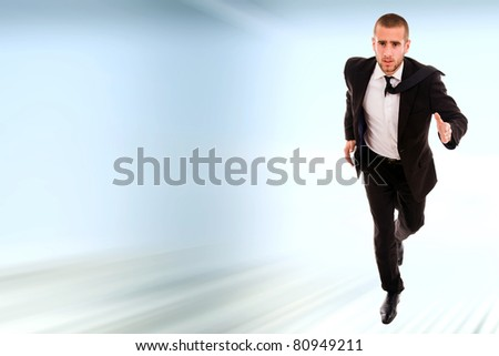Young business man running