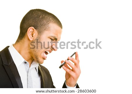 Young business man screaming into his mobile phone - stock photo