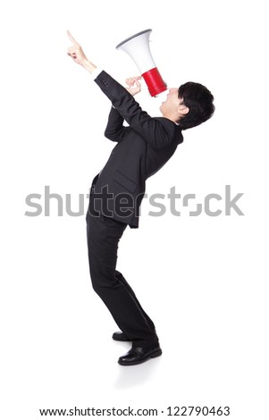Young business man shouting into a megaphone and finger point to up forward in full length isolated over a white background, asian model