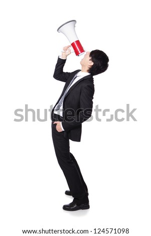 Young business man shouting into a megaphone in full length isolated over a white background, profile side view, asian model
