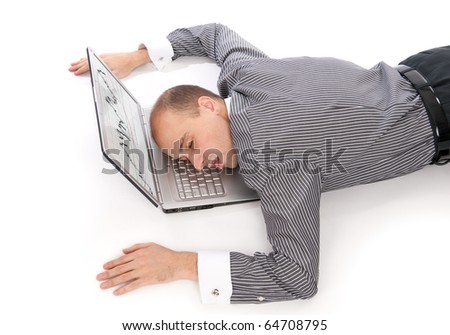 young business man sleeping on the laptop