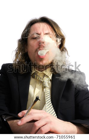 Young business man smoking weed after work