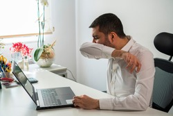 Young Business Man Sneezing. Coughing Into His Sleeve or Elbow to Prevent Spread Covid-19. Corona Virus, Sick Man Has Flu.