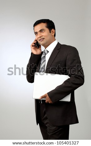 Young  business man talking on the phone