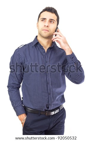 Young business man talking on the phone with hand in pocket.White background