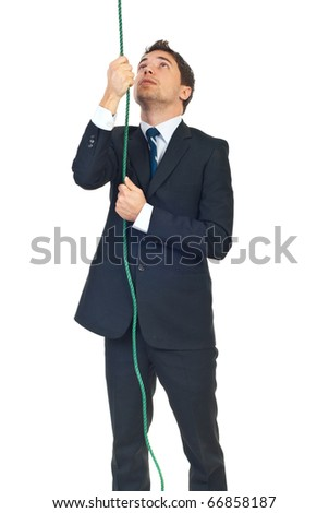 Young business man trying to climbing rope and looking up isolated on white background