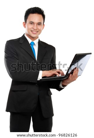 young business man using laptop isolated on white