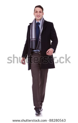 young business man walking forward over white background