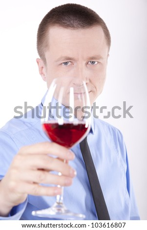 Young business man with a glass of wine.