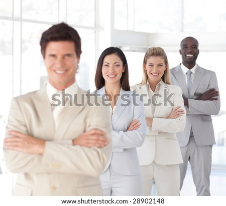 Young Business man with arms folded in front of Business Team (Focus on third person from the front)