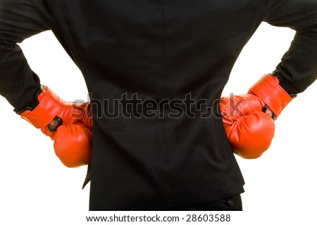 Young business man with boxing gloves puts his hands at his hips