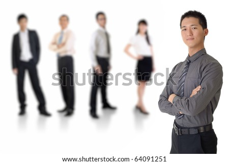 Young business man with his team over white background.
