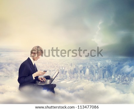 Young Business Man with Laptop and Phone on Top of the City
