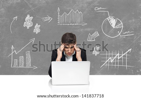 Young business man with laptop brainstorming. Business concept in sketch draw - stock photo