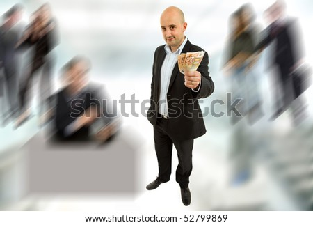 young business man with money, full length picture