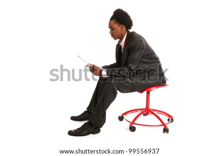 Young business man with tablet PC in studio