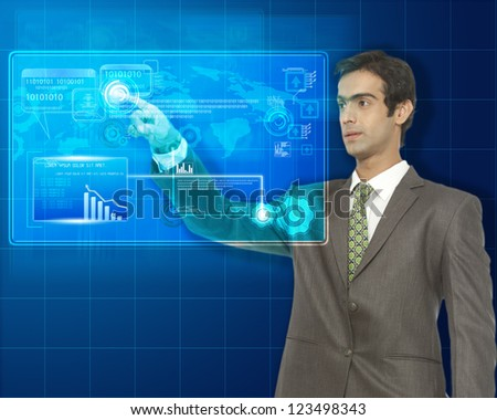 young business man working on futuristic virtual screen