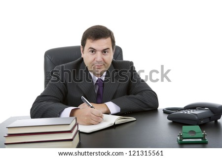 young business man writing on a desk