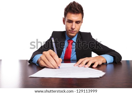 young business man writing something at the desk