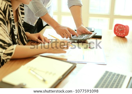 young business managers crew working with new startup project.Notebook paper work on wood table, Team meeting concept  #1077591098
