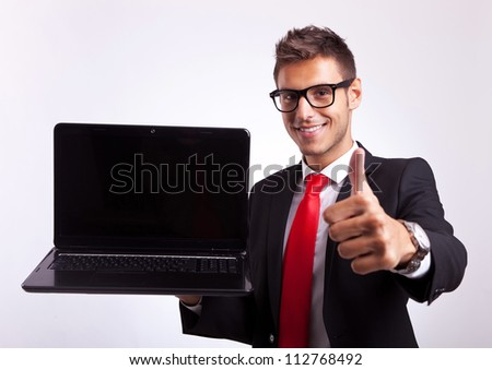young business manor student giving the ok for the new laptop computer