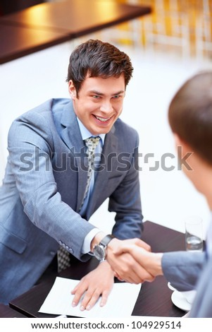 Young business men shake hands