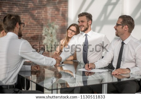 young business partners shaking hands at the Desk #1130511833