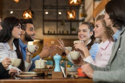 Young Business People Group Drink Coffee Sitting Cafe Table, Friends Hold Cup Smiling Mix Race Men Women Talking