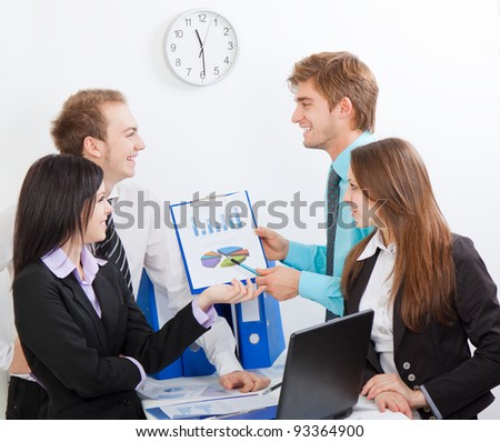 young business people happy smile working on project in team together, businessmen and women discussing the financial diagram, graph, business charts, businesspeople meeting sitting at desk office - stock photo