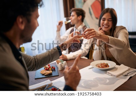 Young business people having good time at business lunch in a relaxed atmosphere at the restaurant. Business, restaurant, lunch Photo stock ©