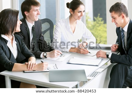Young business people in a meeting at office