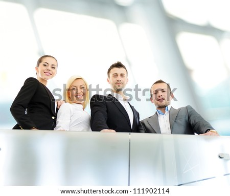 Young business people on railing