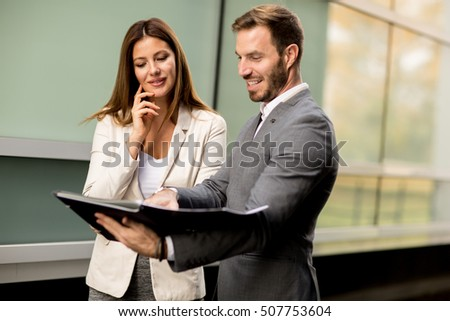 Young business people talking and viewing documents outdoor #507753604