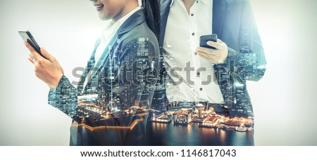 Young business people using mobile phone with modern city buildings background. Future telecommunication technology and internet of things ( IOT ) concept. #1146817043