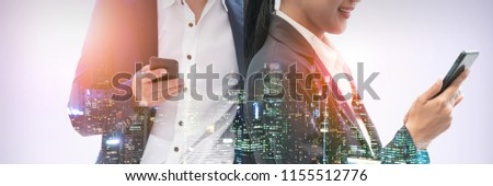 Young business people using mobile phone with modern city buildings background. Future telecommunication technology and internet of things ( IOT ) concept. #1155512776