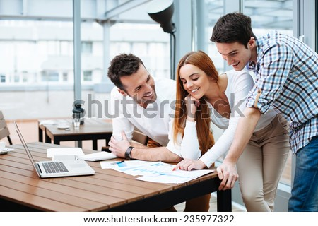 Shutterstock Young business people working at office on new project