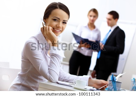 Young business people working in office together