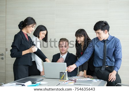 Young Business people working together with happy emotion when finish online meeting. Business people takling in modern office. business team success concept #754635643