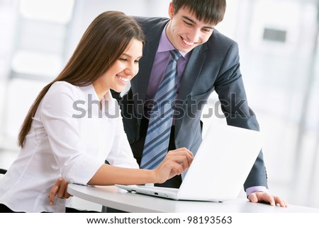 Young business people working with laptop - stock photo
