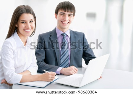 Young business people working with laptop